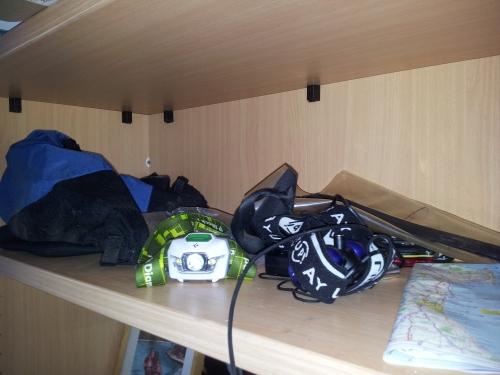 Random gear on a bookshelf